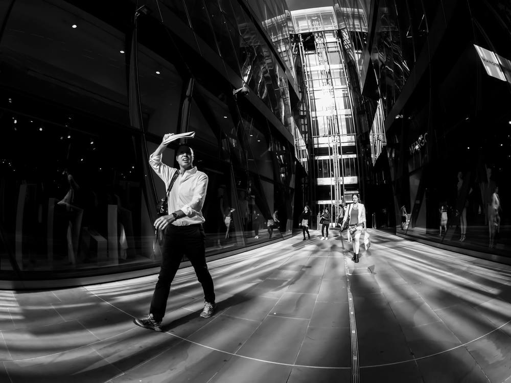 A photograph of people taken at One New Change shopping mall using a Fisheye lens in London