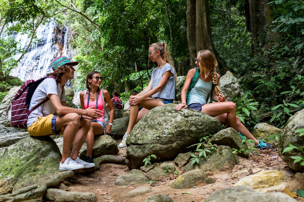 young-tourists-are-resting-on-the-rocks-in-the-jungle-69727697.jpg