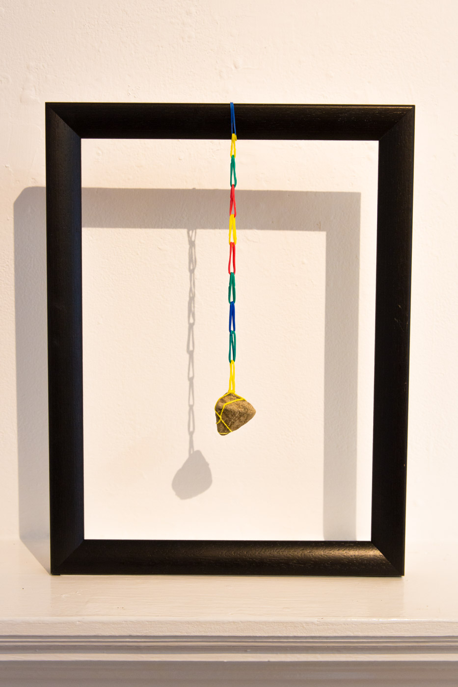 Armegeddon, collected object, 2014   Elastic bands, frame, Megaddo stone