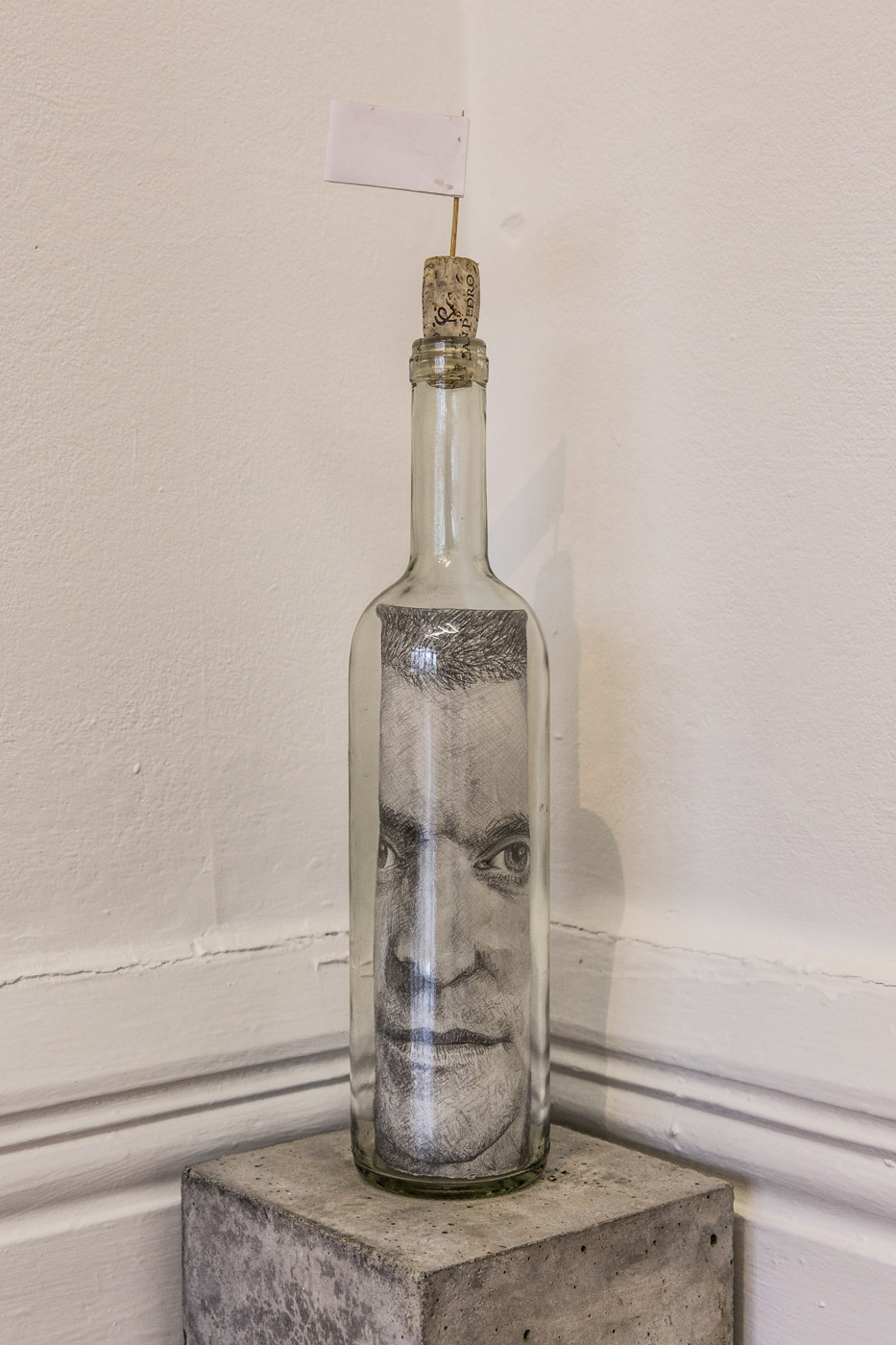 Bottled, drawing, 2014   wine bottle, cork, flag, drawing on paper, concrete block