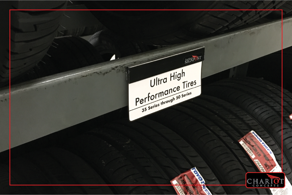 The Slat&Rack Signpost also works on tire racks! It attaches via its double-stick foam adhesive backing and provides a quick-change sign clamp for all kinds of purposes. Label sections of rack. Do you have a particular tire on sale? Place the ad in the clamp directly over the tires on sale!