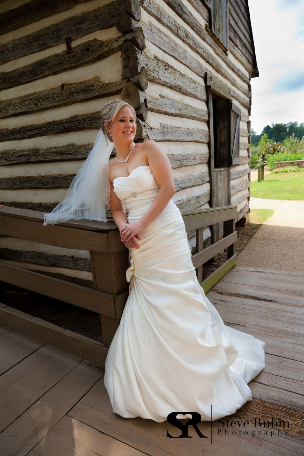 Bride outdoor Portrait with Barn at Joyner Park