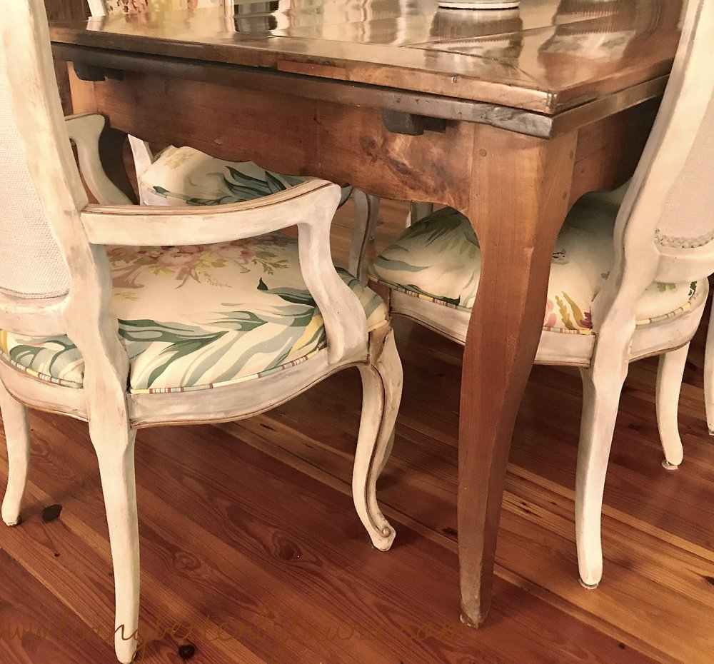 countless families have enjoyed meals on this 18th century antique French draw table over time, including mine. The Chairs are reproduction that I have refinished  - post to follow soon.