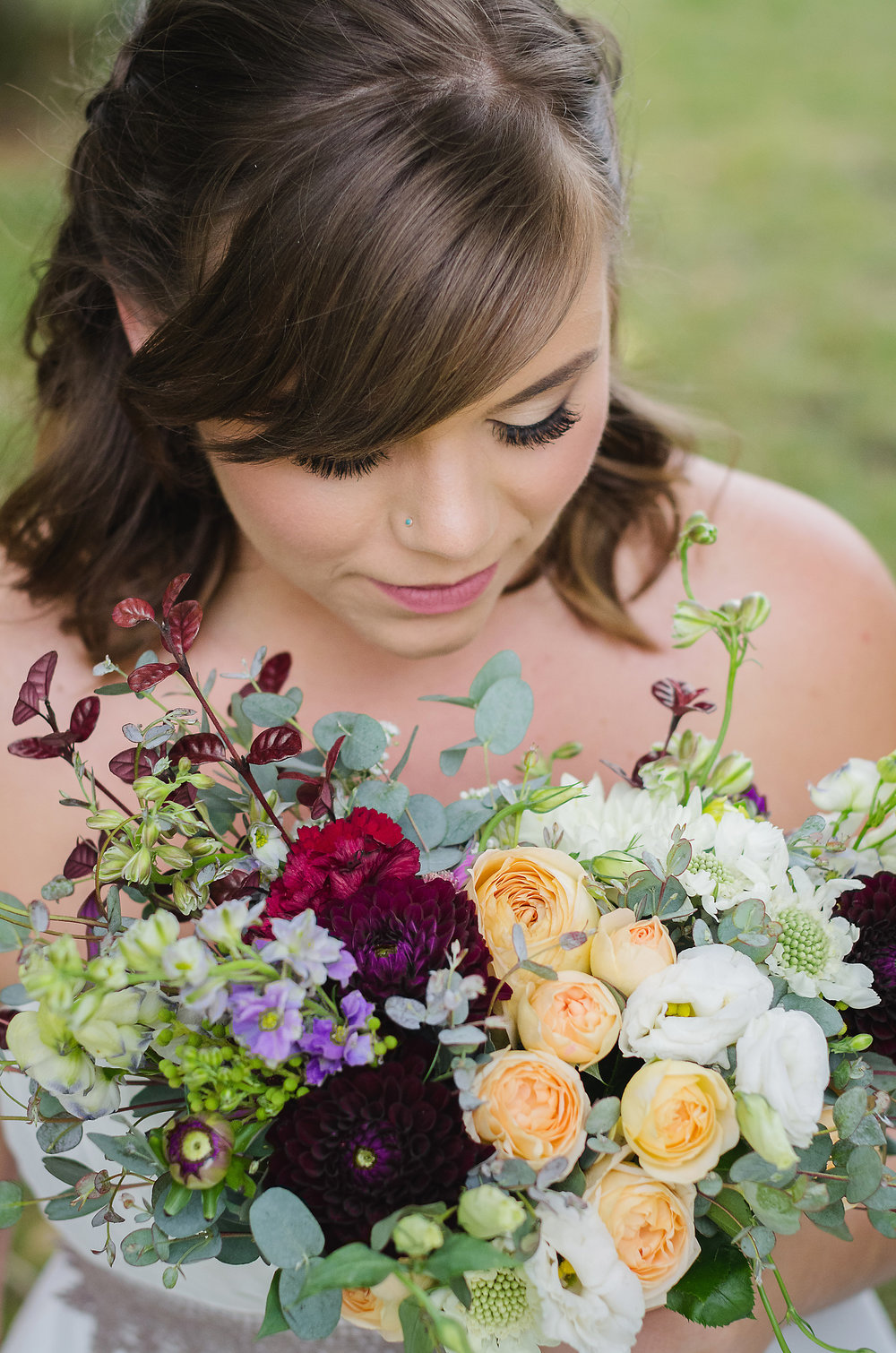 Calgary bride with her colourful bouquet made by Rhosyn Floral