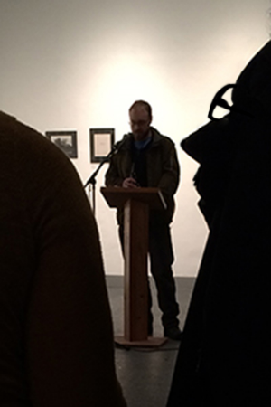 Artist Darren Houser reading his literary work