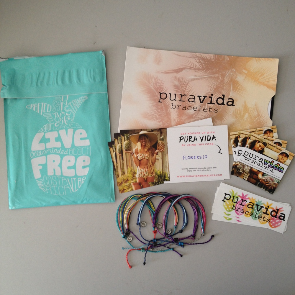 Everything in my rep kit: five bracelets, three stickers, three square cards and three code sharing cards.