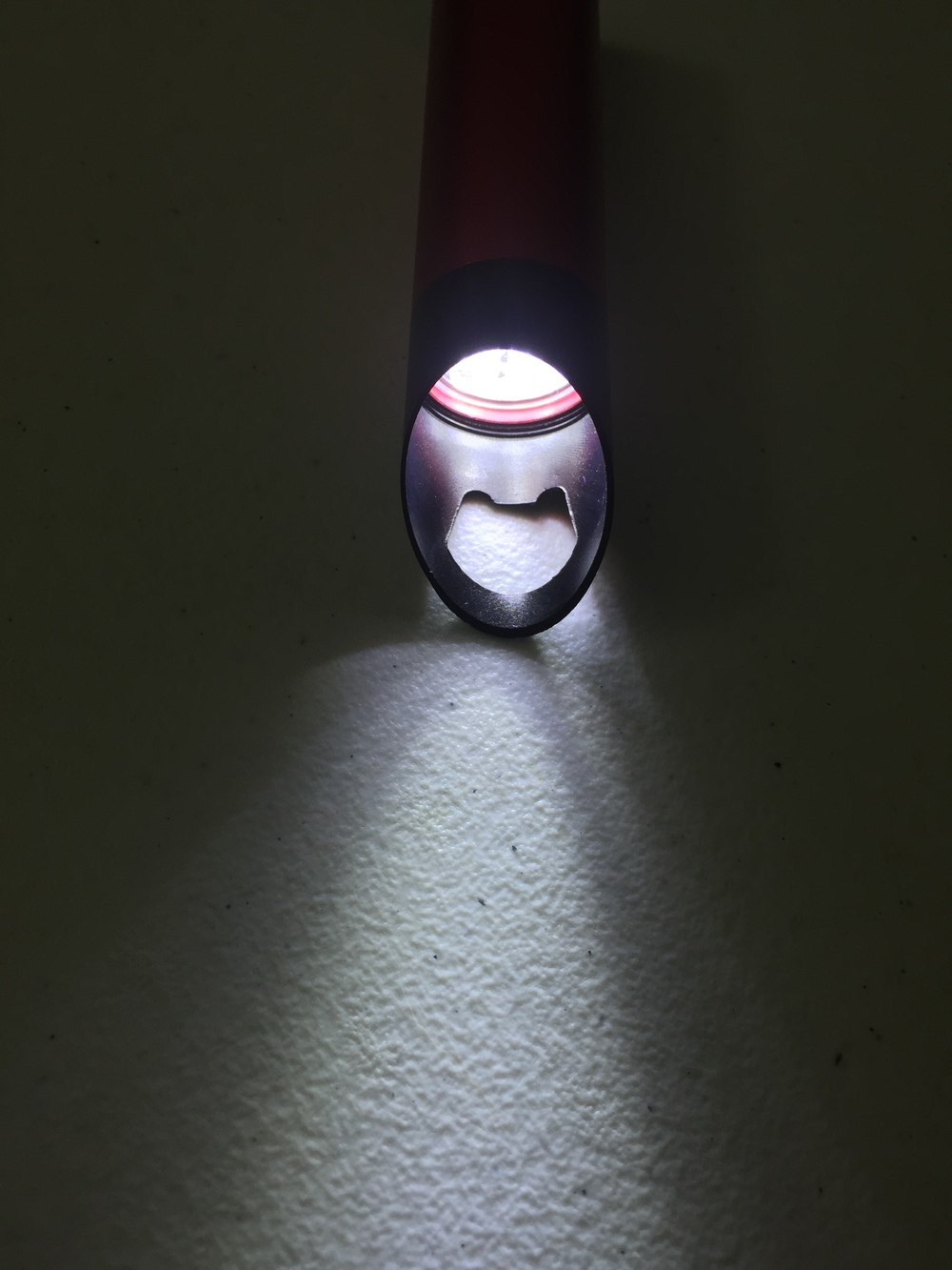 The generous bonus of a flashlight (even has the batteries!) with a built in bottle opener.