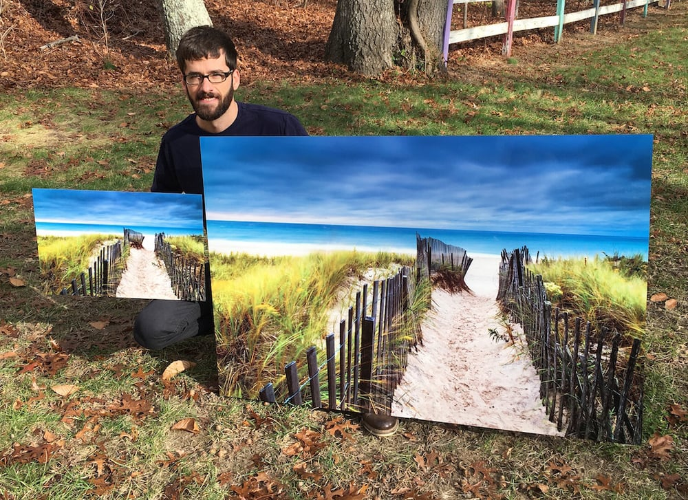 "Myself alongside 2 metal prints of ""Flying Point Beach Vista"""