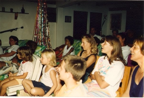 (My little beach family, watching our little puppet theater productions. I can't believe I still have this photo!)
