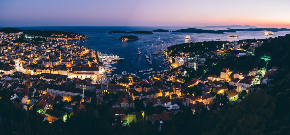 Hvar city harbor at dusk