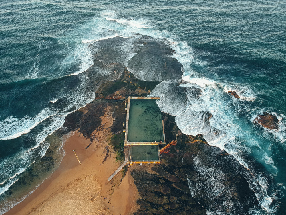 Mona Vale Ocean Pool is surrounded by waves on three sides