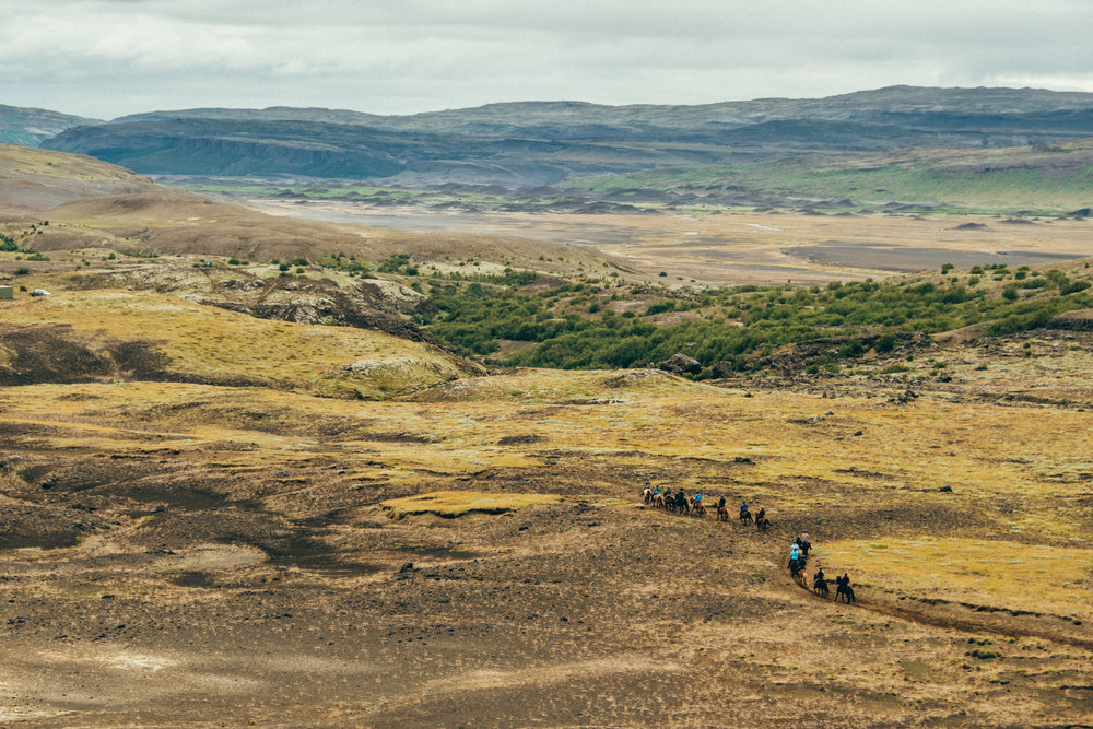 Riders on horseback approaching the Gjáin valley