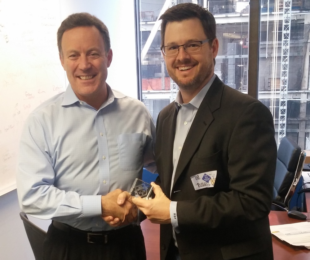 Booker.com's Senior Vice President of Marketing Jim  D'Arcangelo (L) accepting the 2016 BIG Innovation Award in New York.from Business Intelligence Group's Managing Director Russ Fordyce (R).