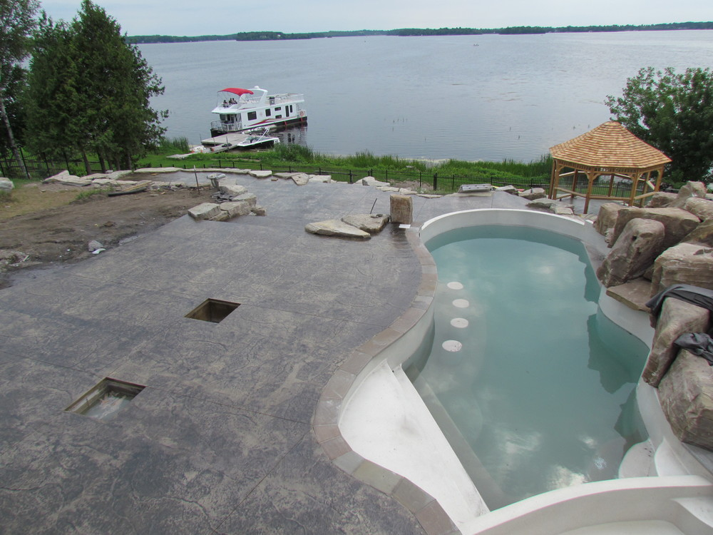 Seamless Roughstone pool deck in Buff colouring.JPG