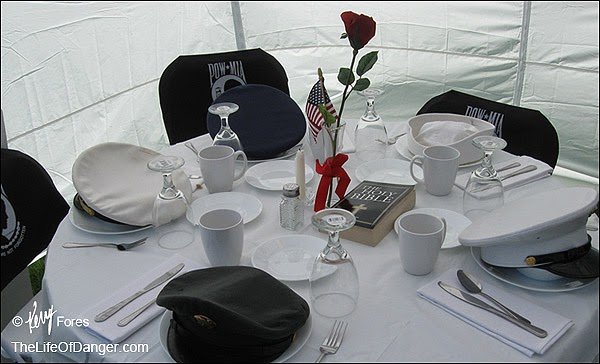 A linen-covered table carefully prepared for guests whom could not attend.