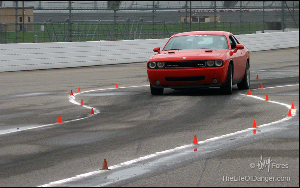 Mark, challenging his Dodge Challenger SRT before heavy rain hastened the end of the driving events.