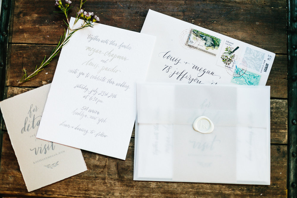 Handwritten two-color letterpress invite + detail card with custom postage design and wax seal