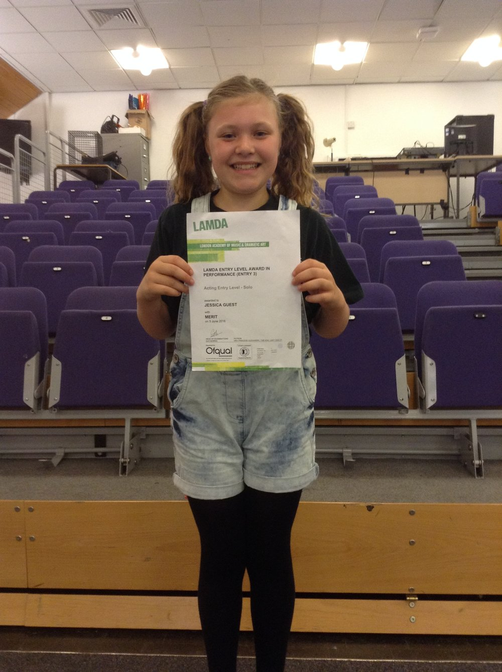 Jess with her LAMDA certificate