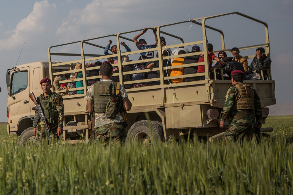 People will be transported in trucks away from the frontlines by Peshmerga forces. April 8, 2015.