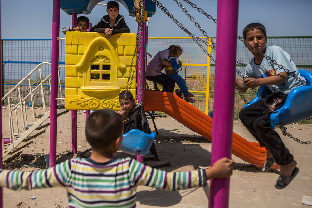 Children play in the playground of the camp, that has been increasing it's capacity in the past weeks.