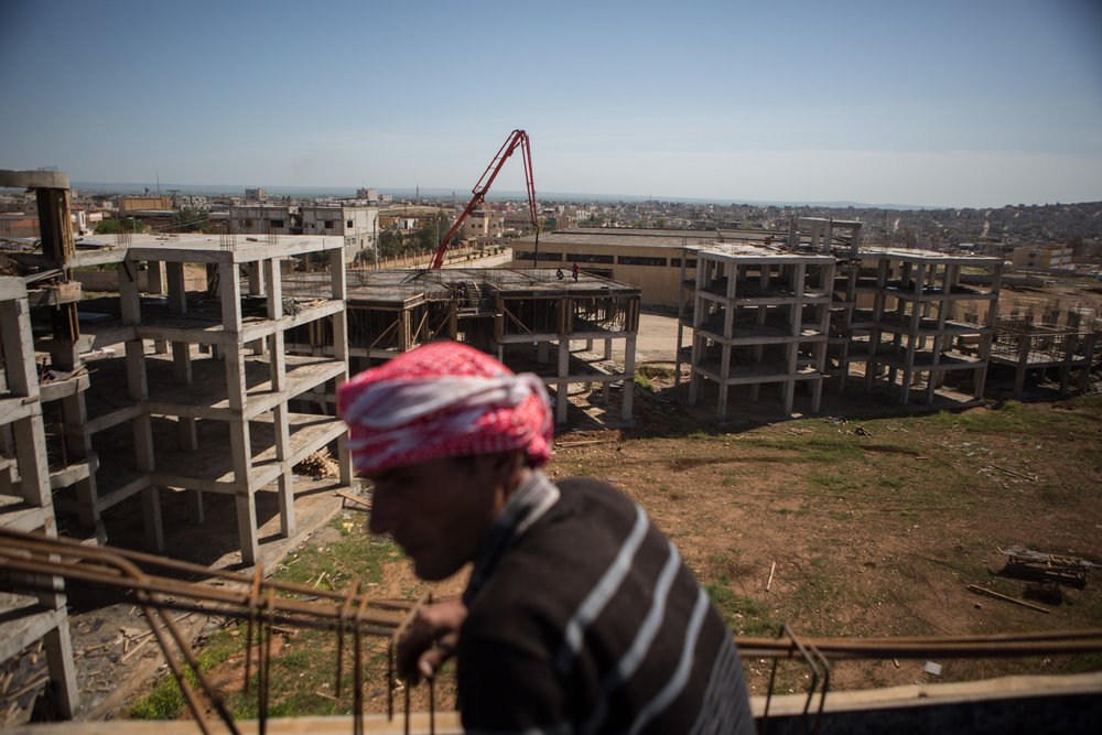 A new apartment project is being built. The project is intended to house some of the poorest families whose houses were destroyed as well as families of the fighters that died during the battle.