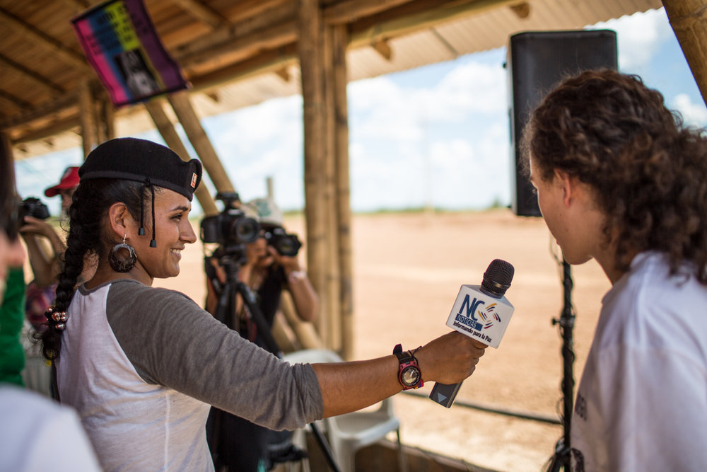 A member of NC News (New Colombia) the FARC online news magazine, interviews a young attendee from Bogotá.