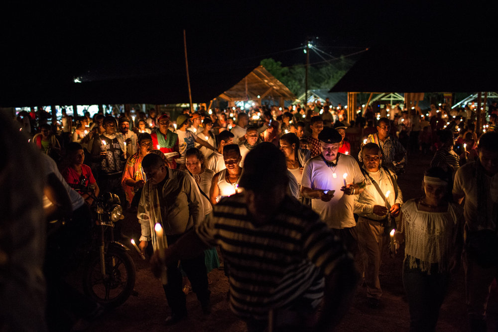 Attendees make a small walk holding candles in the vigil for the peace where civil groups and FARC members shared activities in support of the continuation and implementation of the peace agreements despite the negative result in the October 3d referendum.