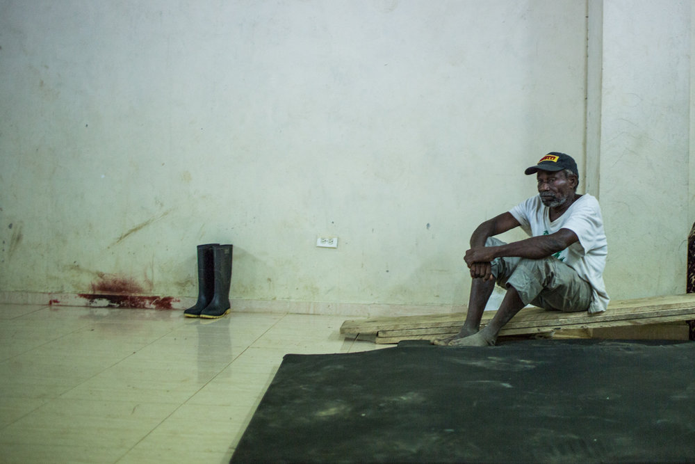 A displaced sits inside the shelter where the displaced persons are sleeping since March 3.