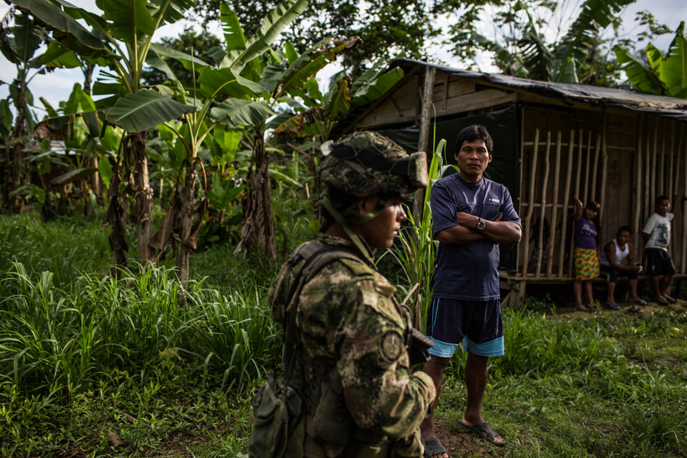An army soldier patrols Pie de Pato town, where displaced persons have arrived.