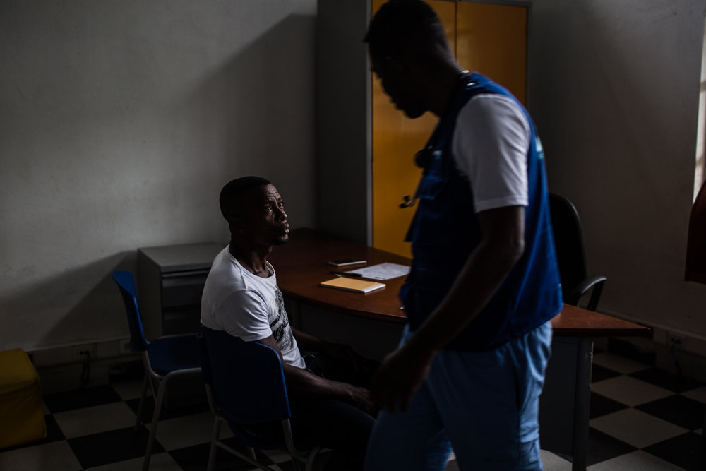 A regional government medic in Pie de Pato attends a displaced man.