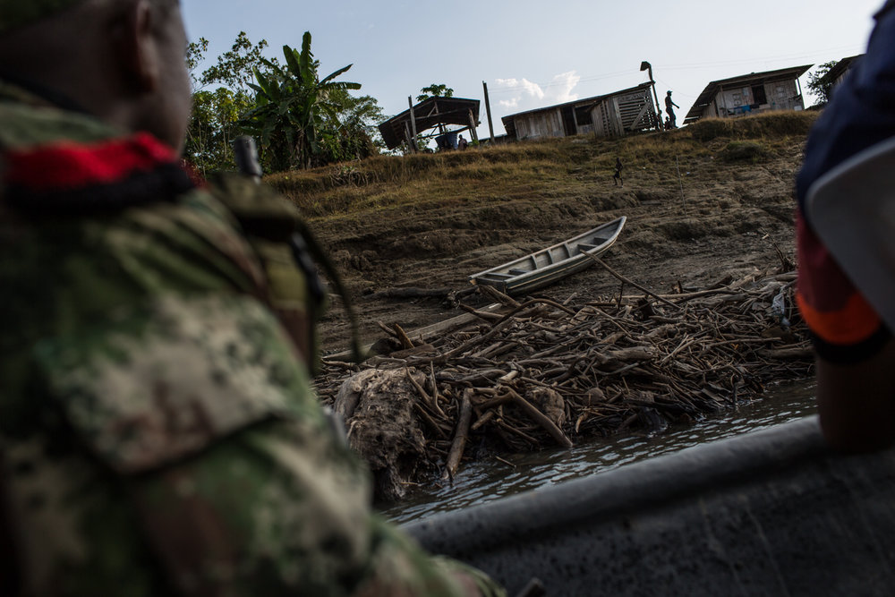 ELN members arrive to an afro-Colombian community in the shores of the San Juan River. For almost two decades this area has been controlled by FARC, ELN and paramilitary forces.