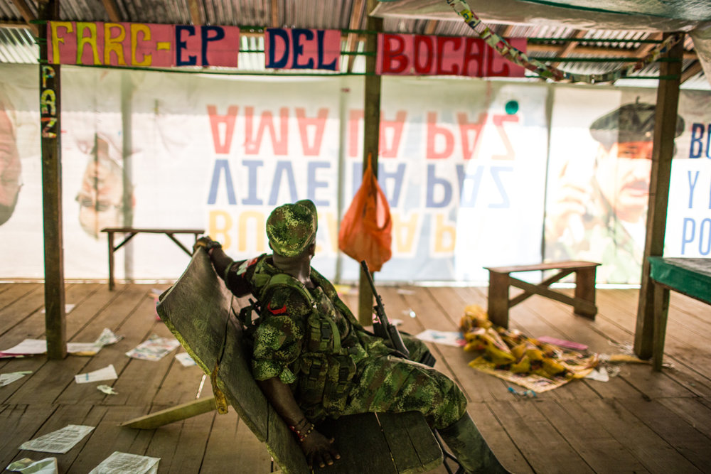An ELN member rests inside what used to be a FARC unit camp, which left weeks before in accordance to the peace implementation agreements with the government.