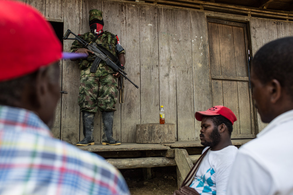 ELN member of the area talks to community leaders before liberating an alleged ex FARC- fighter that had return to his community without previous authorization.