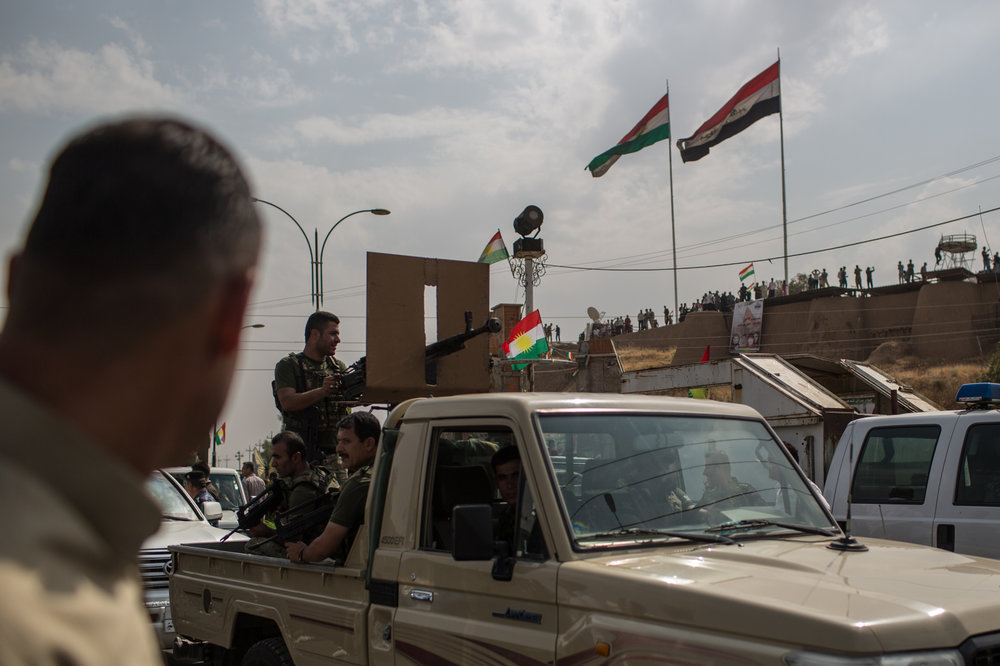 Peshmerga fighters deploy in central Kirkuk prior to a rally organized in as part of a large campaign for the referendum .