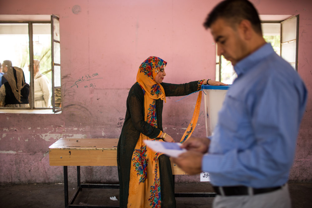 During the day people arrived to different voting stations in Kirkuk to vote .