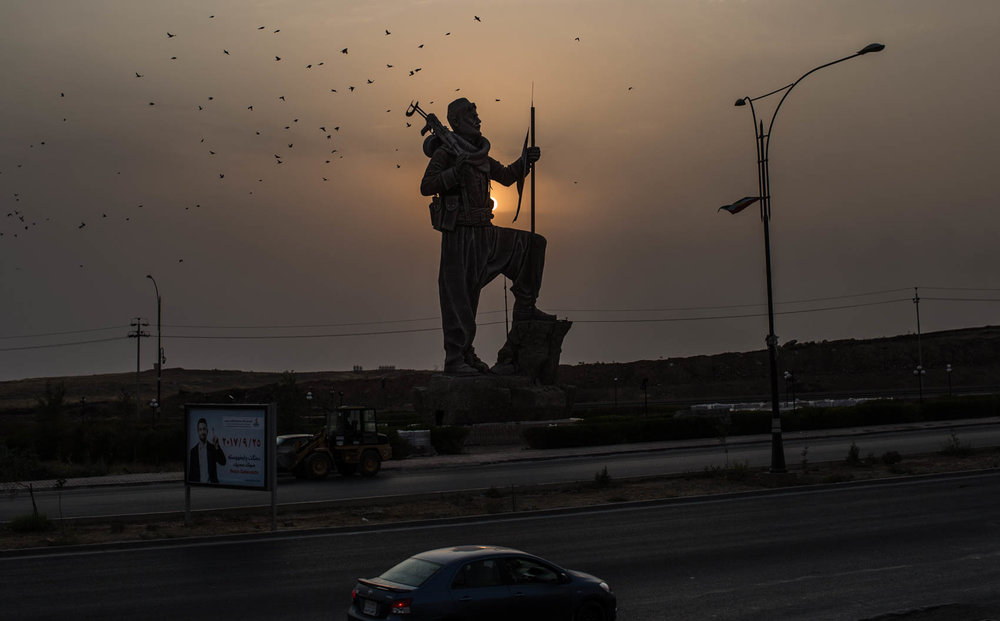 The statue of a peshmerga soldier is seen in the entrance of Kirkuk the contested city between the KRG and the central Iraqi government.