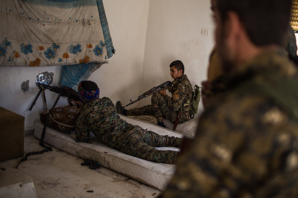 Occasional fire is exchanged by ISIS fighters in the National Hospital and SDF forces in the west front line.