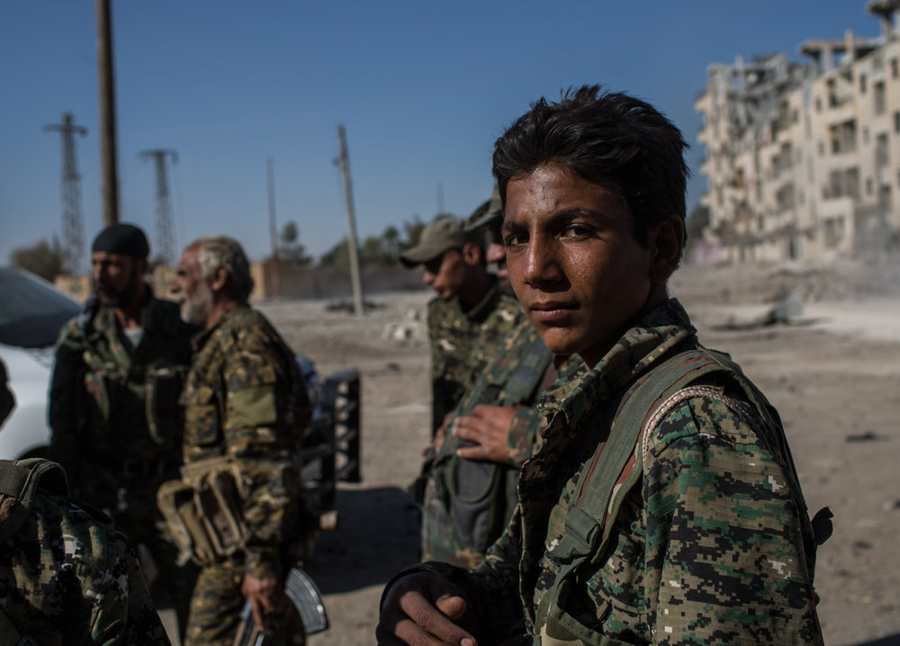 A young arab fighter prepares to move to the front line in the west side of the city of Raqqa.