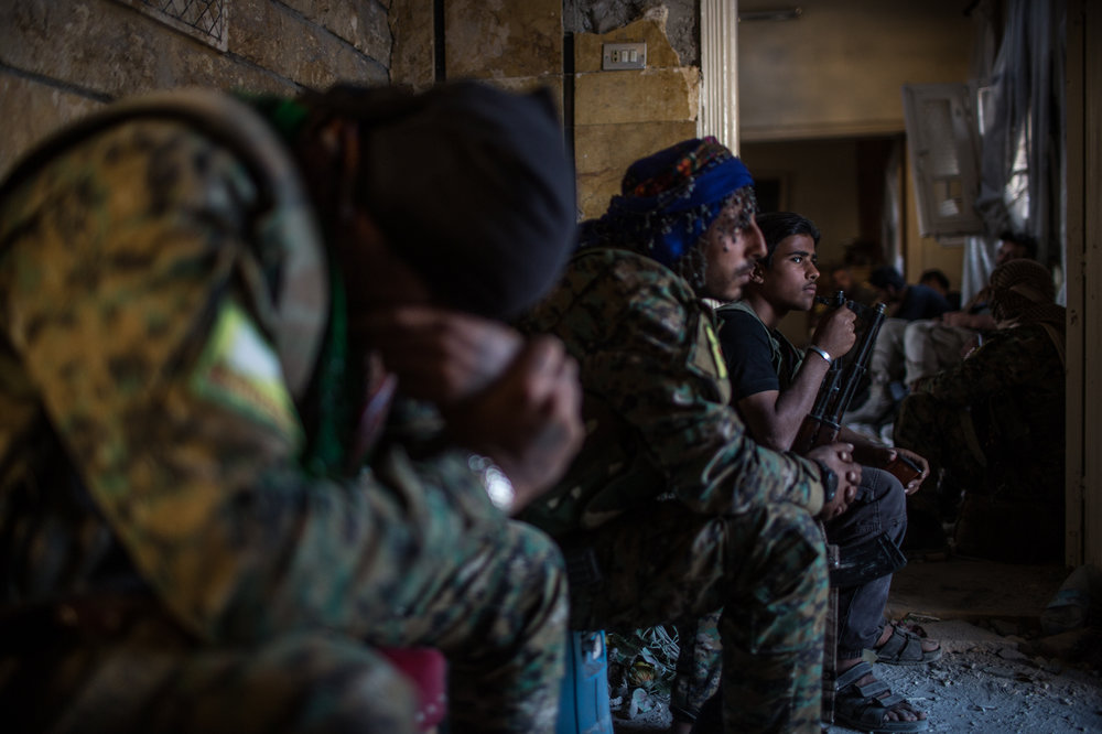 An SDF unit waits inside a destroyed house while some occasional shelling hits the nearby area in the western front.