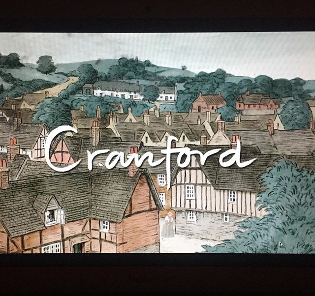 Sick in bed. Curtains drawn and lights dimmed. Cranford on my lap.