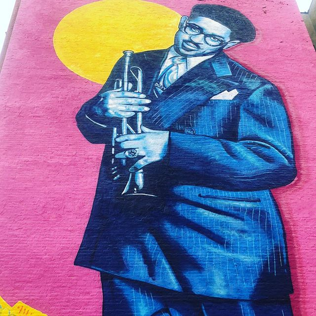 """#Repost @lamaisondartny with @get_repost ・・・ """"Education is not a Crime"""" - 100th anniversary Mural by Brandan """"B-Mike"""" & Marthalicia Mattarita - mural celebrating the life and principles of Dizzy Gillespie, African-American jazz legend, Harlem icon, Baha'i and humanitarian.  part of a worldwide education equality and street art campaign for the Baha'is in Iran and for all communities of struggle! Loving #harlem murals! Always a smile on our face to see familiar and talented artist friends @nycm2  #greaterharlemchamber #streetartanarchy #educationisnotacrime #dizzygillespie #harlemartsalliance #harlemweek #worldart #internationalart #bridgingcultures 135 btwn Acp/Fdb"""