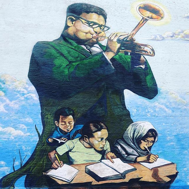 """""""Education is not a Crime"""" - 100th anniversary Mural by Brandan """"B-Mike"""" & Marthalicia Mattarita - mural celebrating the life and principles of Dizzy Gillespie, African-American jazz legend, Harlem icon, Baha'i and humanitarian.  part of a worldwide education equality and street art campaign for the Baha'is in Iran and for all communities of struggle! Loving #harlem murals! Always a smile on our face to see familiar and talented artist friends @nycm2  #greaterharlemchamber #streetartanarchy #educationisnotacrime #dizzygillespie #harlemartsalliance #harlemweek #worldart #internationalart #bridgingcultures 135 btwn Acp/Fdb"""