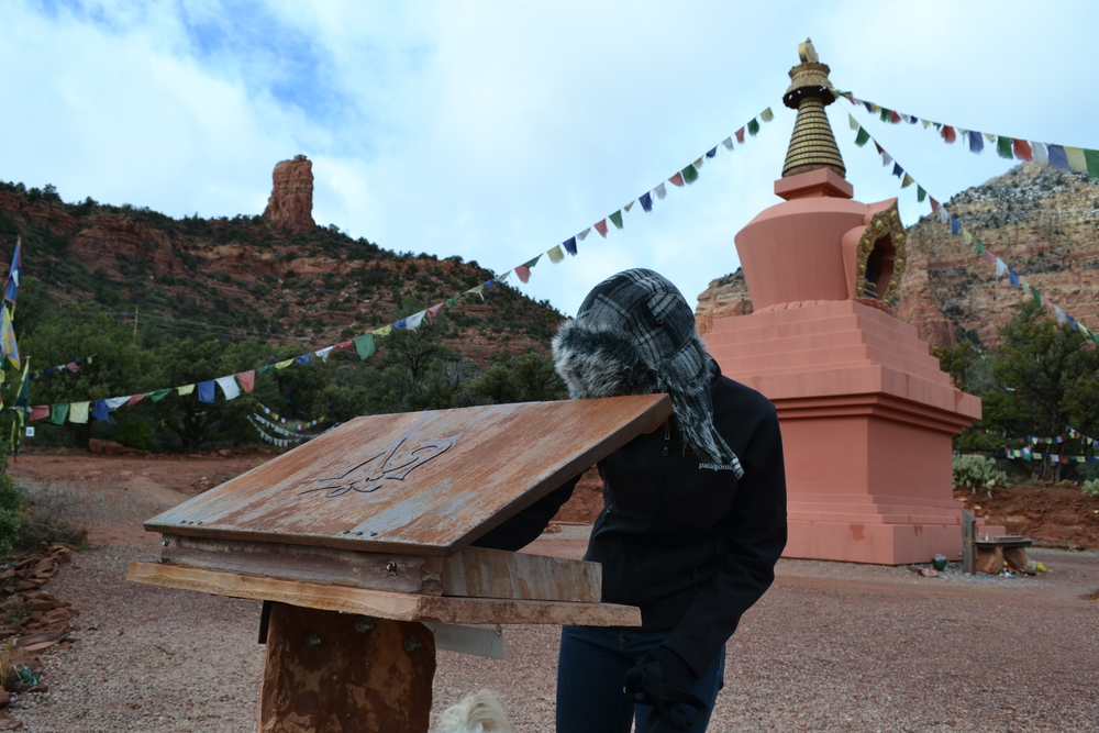 Mel signs the guestbook for Local Color XC at The Amitabha Stupa & Peace Park