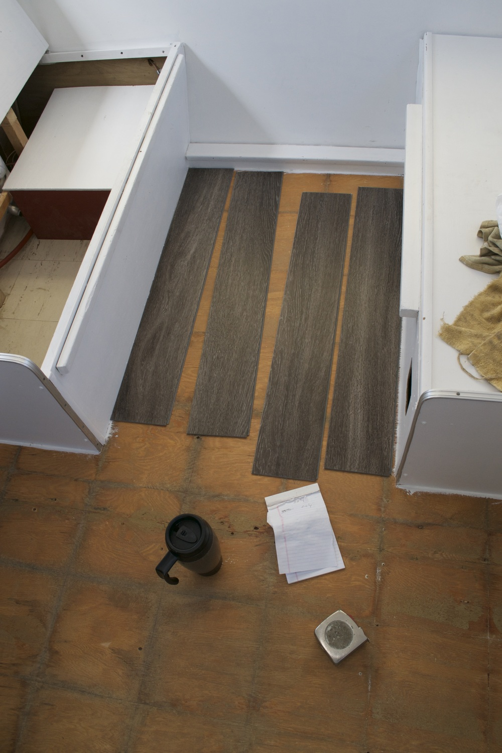 Reasons to install vinyl plank flooring in your trailer or rv required tools measuring tape flooring coffee scratch pad dailygadgetfo Images