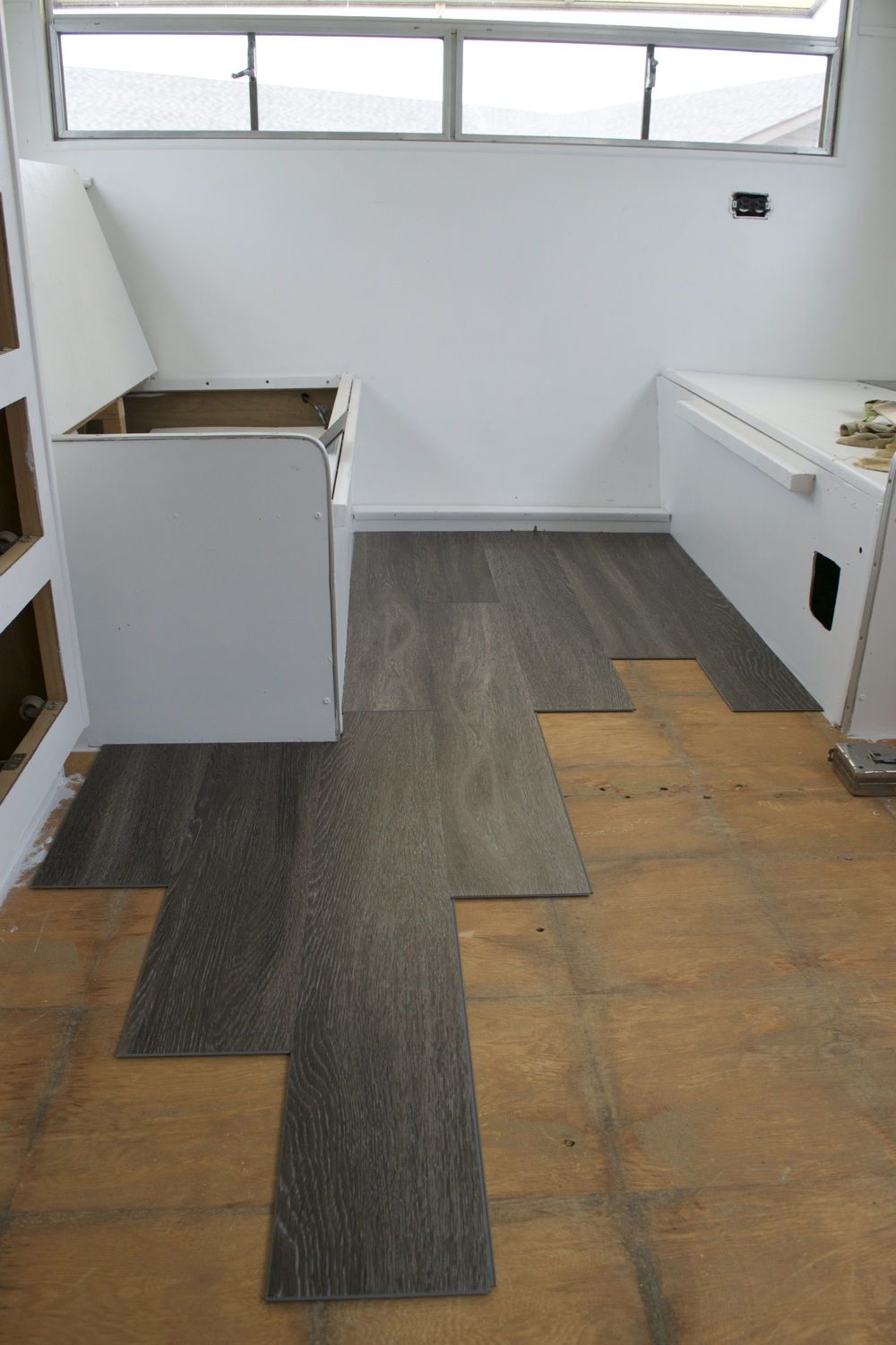Reasons to install vinyl plank flooring in your trailer or rv the boys started between our two dinette benches dailygadgetfo Image collections