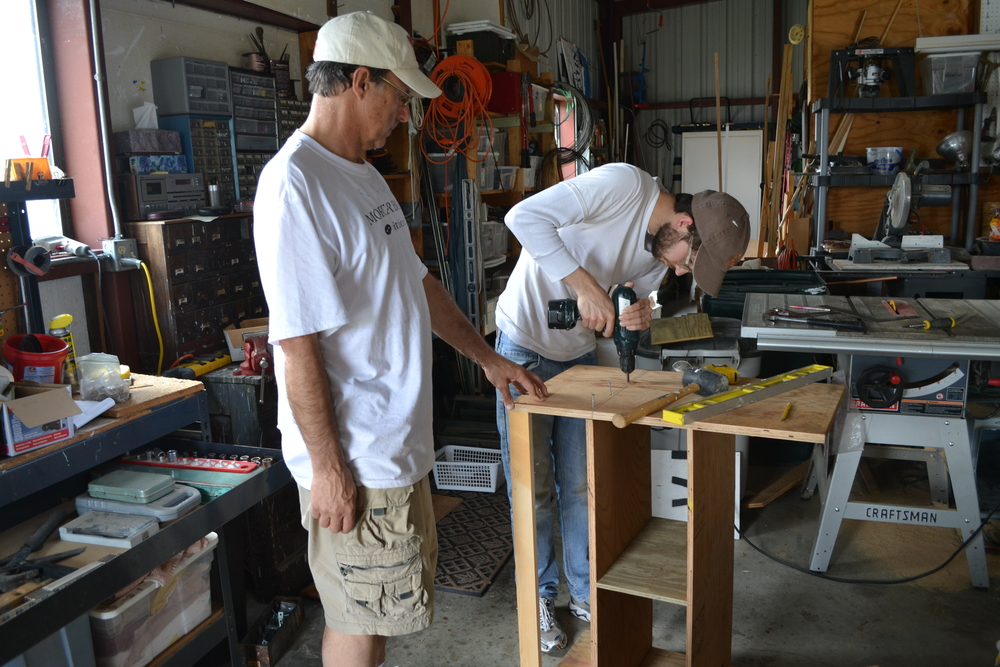 The guys rebuilding and working and drilling and stuff in Jerry's workshop.