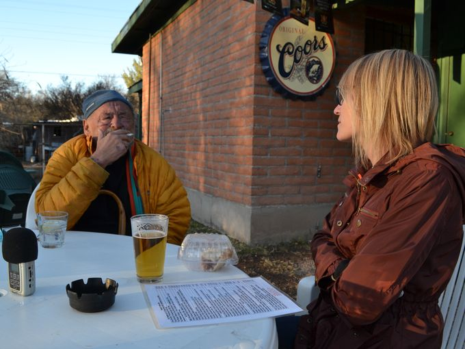That's Mel chatting with novelist Jim Harrison at the Wagon Wheel Saloon. Yes, she is considering the chicken enchiladas. And yes, that is a half eaten piece of rhubarb pie from Gathering Grounds Cafe, also in Patagonia, Ariz.