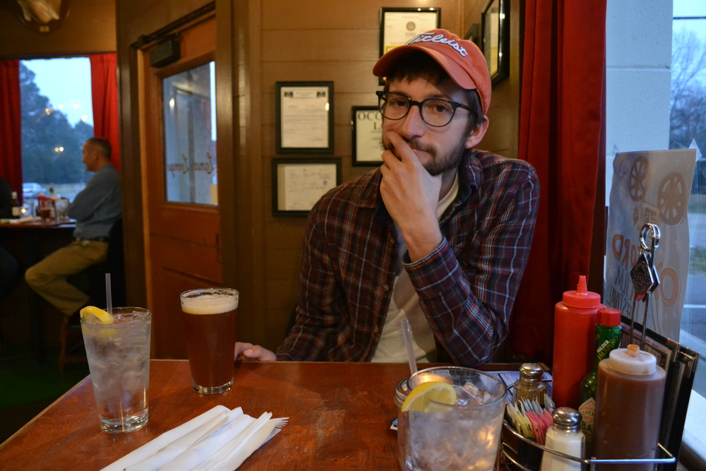 Carson relaxes with a beer at Lamar Lounge after an afternoon in rural MS.