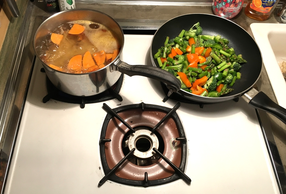 Cooking on our tiny stovetop.