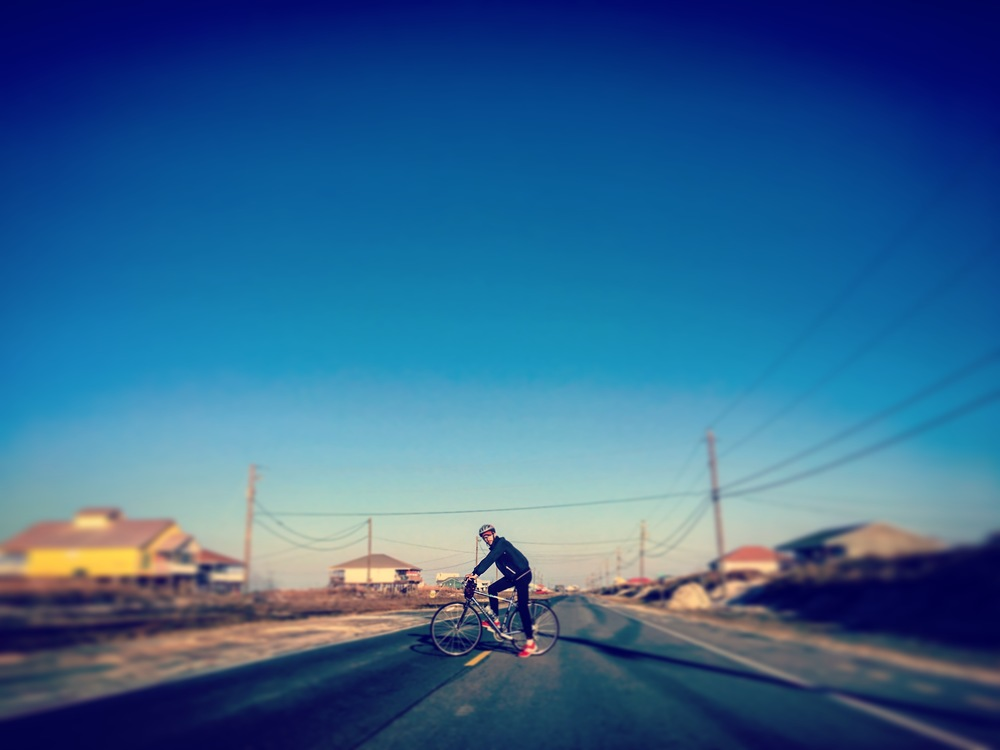 Carson rides his bike along Dauphin Island's trails.